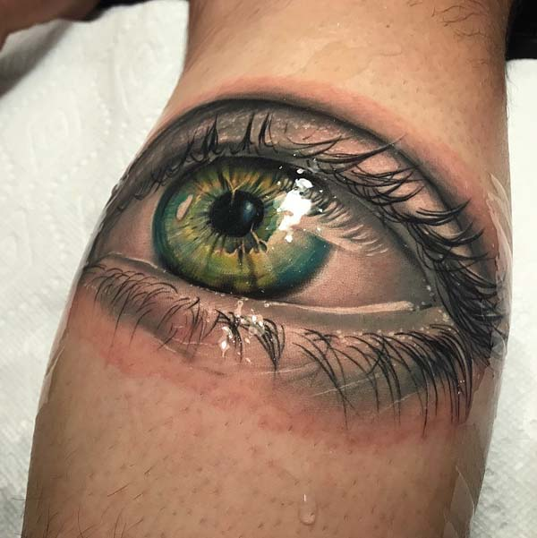 Realistic Eyeball Tattoo With Green Eyes Done In Miami Beach