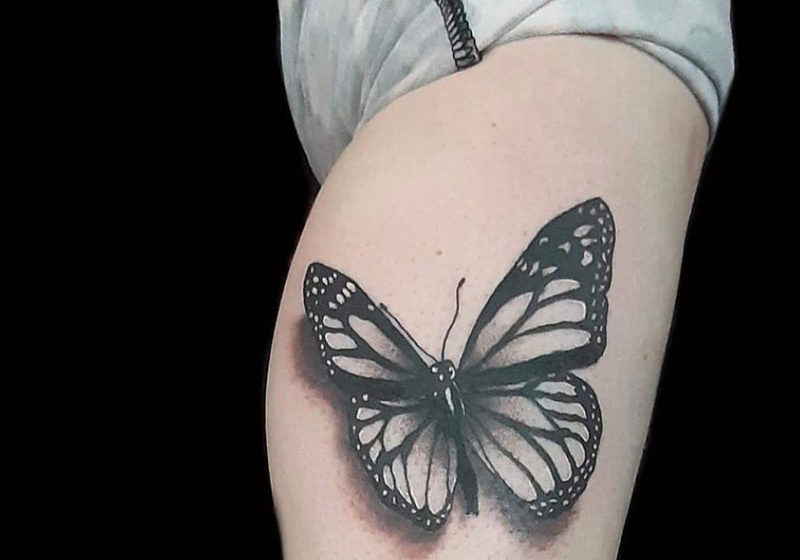 Butterfly tattoo on the hip