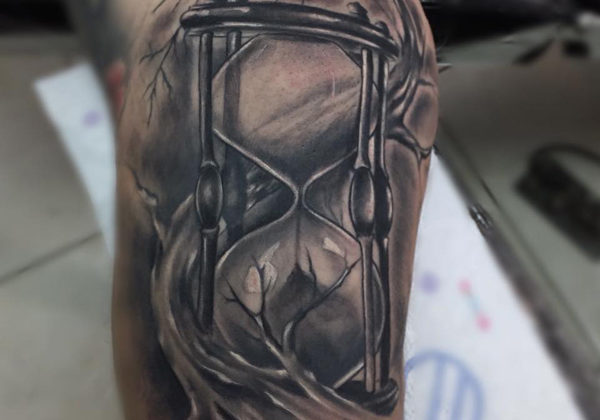 Black And Grey Hour Glass Tattoo