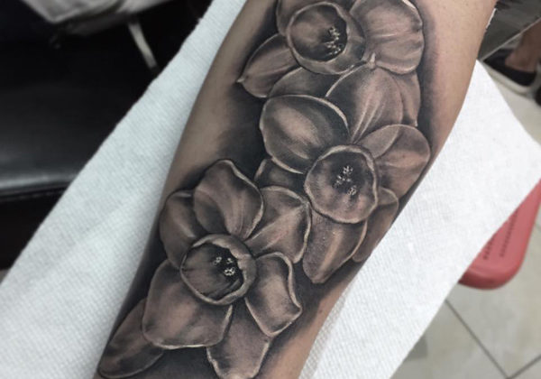 Black and grey realistic flower tattoo