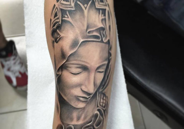 Black and grey realistic virgin marry tattoo on the arm