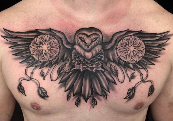 Black and grey owl tattoo on the chest