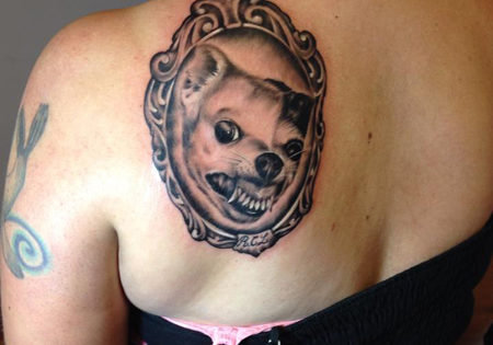 Black and grey realistic portrait of a dog tattoo