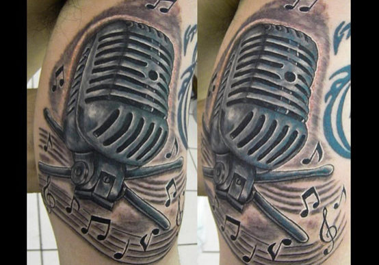 Microphone Tattoo With Music Notes around it