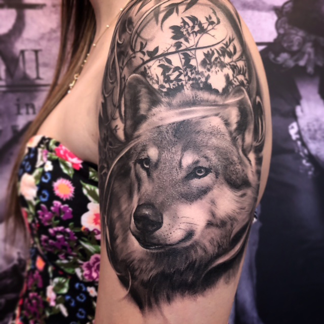 Realistic Wolf Tattoo done at our Tattoo Shop in Miami